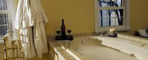 A hot tub with luxury robes and wine at The Lakehouse Inn.