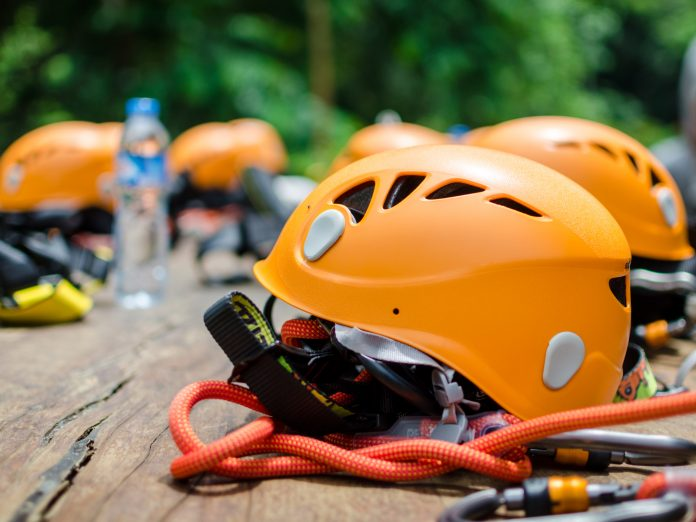 Zip line helmet on the table to prepare for activity with Lake Erie Canopy Tours.