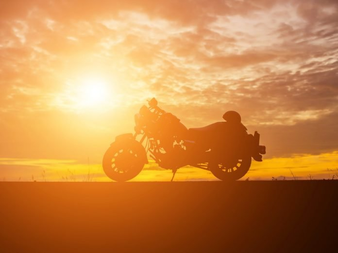 A parked motorcycle in the sunset near the Geneva-on-the-Lake motorcycle rally.