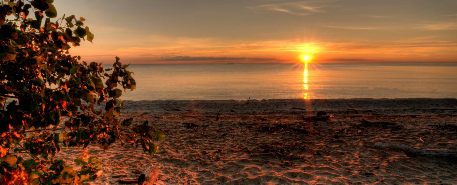 A sunset on the beach at Geneva State Park, one of the parks near Geneva-on-the-Lake, Ohio.