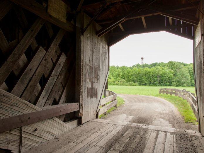 a covered bridge in ashtabula, ohio.