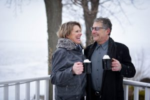 couple with hot chocolate in the snow