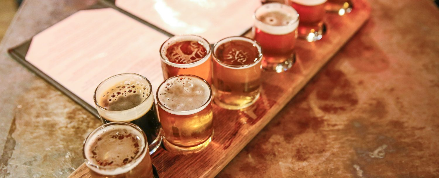Craft beers in taster glasses are lined up for a beer tasting at a craft brewery on Ashtabula's historic Bridge Street.