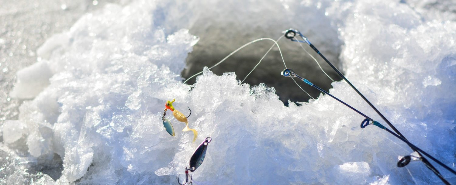 Fishing lures by a fishing hole on the frozen Lake Erie: Lake Erie ice fishing.
