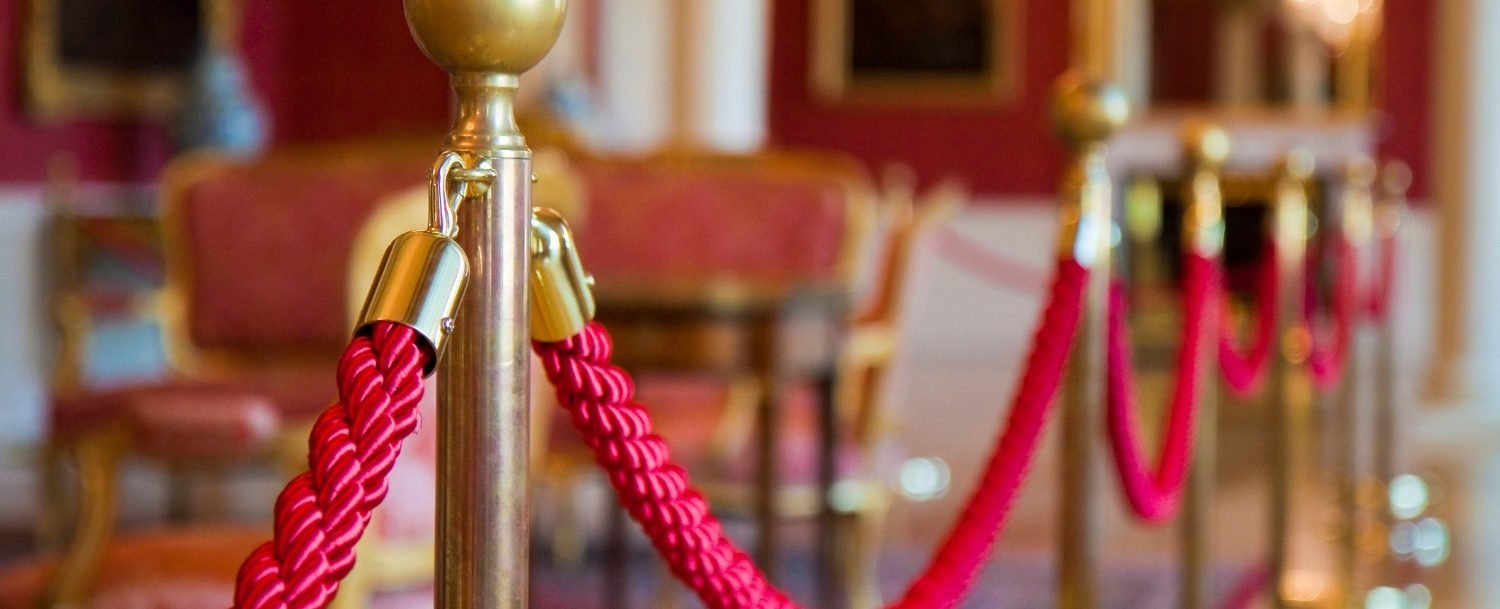 Detail of red rope on a exhibition space at The Ashtabula Lighthouse museum.