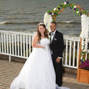A happy bride and groom at a Lake Erie elopement at The Lakehouse Inn Resort. Photography by Michael Allen Blair Photography.