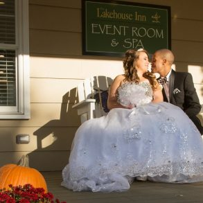 A happily wedded couple at a Lake Erie elopement at The Lakehouse Inn Resort. Photography by Michael Allen Blair Photography.