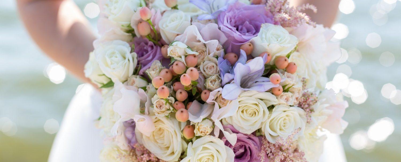 wedding bouquet in hands of the bride: Lake Erie elopements in Northeast Ohio.