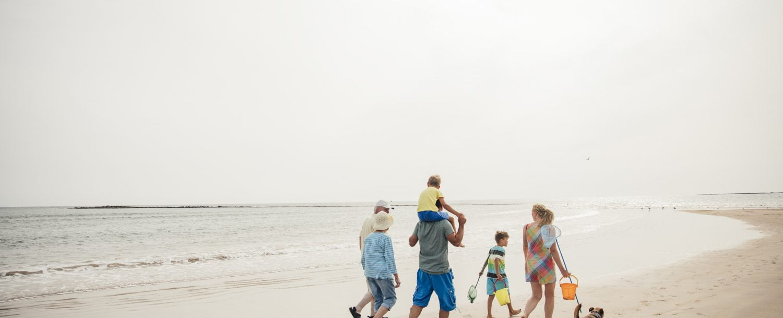 Family walking on Geneva-on-the-Lake beach
